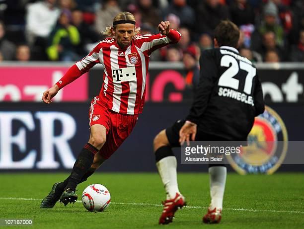 AnatoliyTymoshchuk of Bayern Muenchen kicks the ball against Pirmin Schwegler of Frankfurt to score his team's first goal during the Bundesliga match...