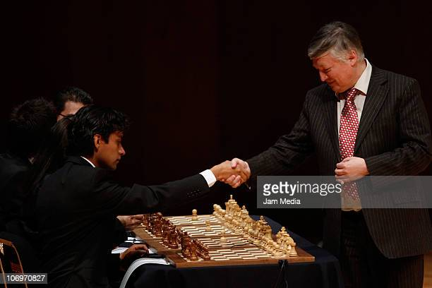 Anatoly Karpov greets participant during the First Gran International Chess Festival 2010 UNAM at Nezahualcoyotl Auditorium on November 18 2010 in...