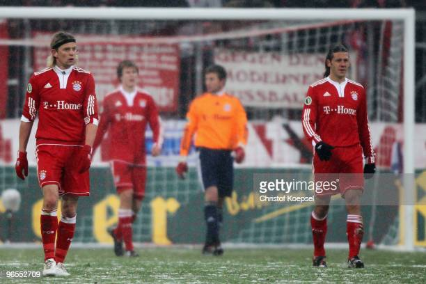 Anatoly Tymoshchuk Holger Badstuber Michael Rensing and Martin Demichelis of Bayern look dejected after the second goal of Fuerth during the DFB Cup...