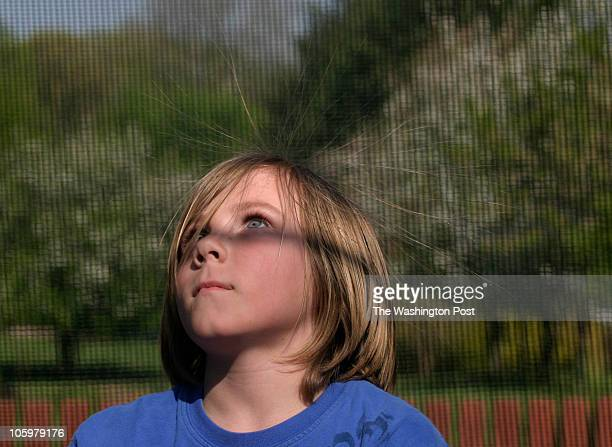 Anatoly Zukor 9 years old plays on trampoline as his hair stands out with static electricity Christina and Ken Zukor adopted four Russian siblings in...