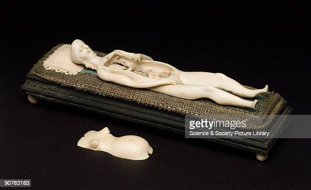 Anatomical figure of a pregnant female with some removable internal organs lying on a couch Possibly German