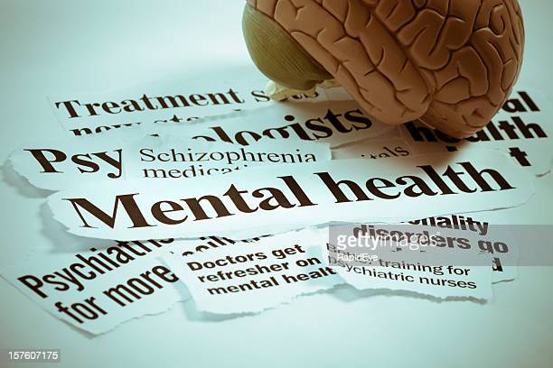 Anatomical model of human brain sits on optimistic headlines