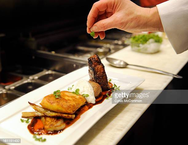 """""""Anatomy of a Dish"""" , the Colorado lamb two ways, a grill t-bone, house made lamb merguez sausage, crisp cous cous pilllows, caramelized fennel,..."""