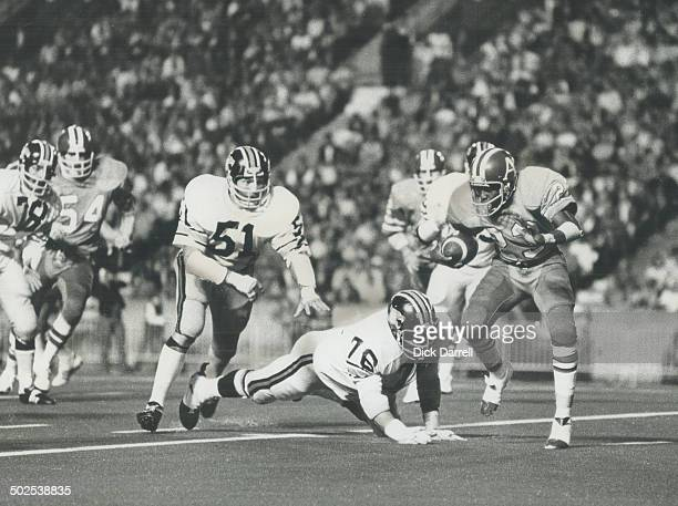Anatomy of a fumble Argos' Eric Allen eludes diving tackle by Bill Baker of British Columbia Lions as Ray Nettles zeroes in on him during last...