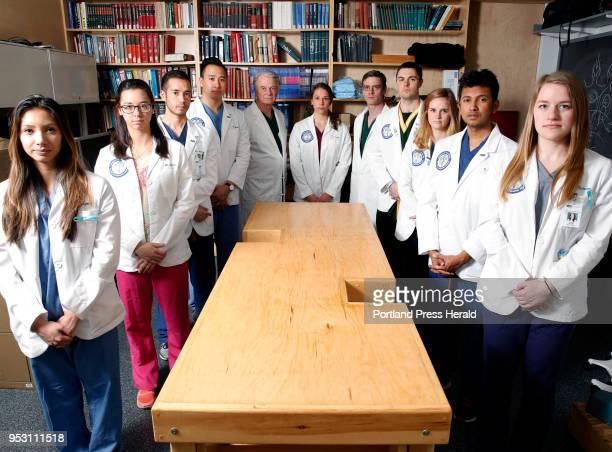 Anatomy students and professors at University of New England pose around a cadaver table for a portrait The need for cadavers a crucial tool for...