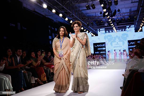 Anavila Misra and Dia Mirza walk the runway during the Anavila show on day 2 as part of Lakme Fashion Week Summer/Resort 2015 at Palladium Hotel on...