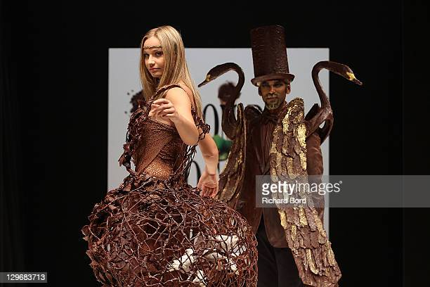 Anca Radici and Satya Oblet walk the runway during the chocolate dress fashion show celebrating 'Salon du Chocolat 2011' opening night at Parc des...
