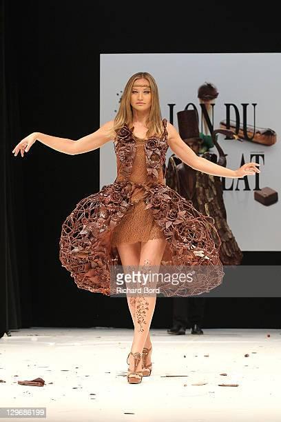 Anca Radici dressed by JeanClaude Jeanson walks the runway during the chocolate dress fashion show celebrating 'Salon du Chocolat 2011' opening night...