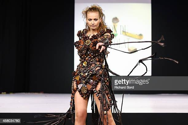 Anca Radici walks the runway and wears a chocolate dress made by stylist Benjamin Bout for Ben Brass and chocolate brand Chocolaterie de Puyricard...