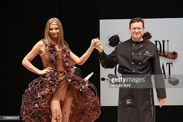 Anca Radici walks the runway with JeanClaude Jeanson during the chocolate dress fashion show celebrating 'Salon du Chocolat 2011' opening night at...