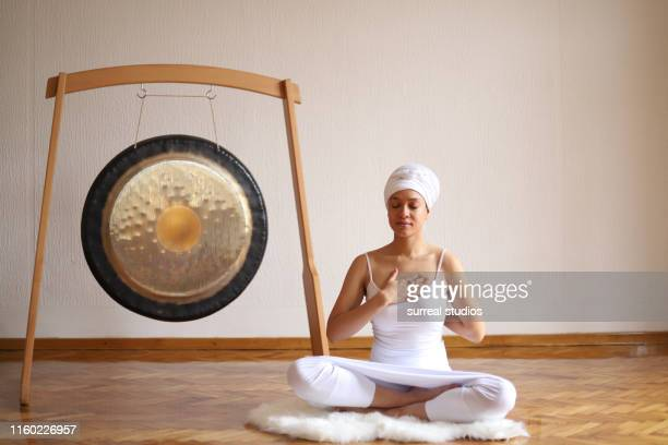 ancestral healing meditation - gong stock pictures, royalty-free photos & images