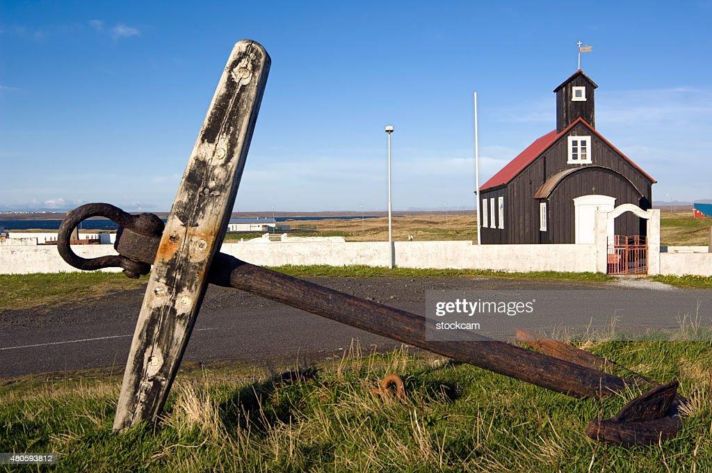 Anchor and church in Hafnir, Iceland : Stock Photo