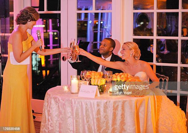MSNBC anchor and NBC News correspondent Craig Melvin and ESPN sports anchor Lindsay Czarniak toast during their wedding reception at the Hay Adams on...
