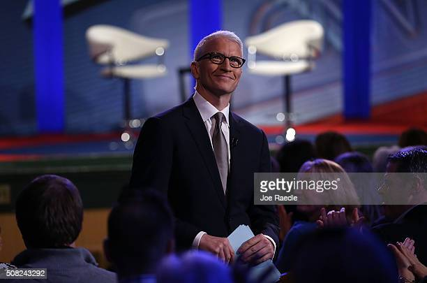 CNN anchor Anderson Cooper looks on during a CNN and the New Hampshire Democratic Party hosted Democratic Presidential Town Hall at the Derry Opera...