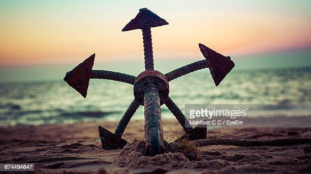 Anchor At Beach Against Sky