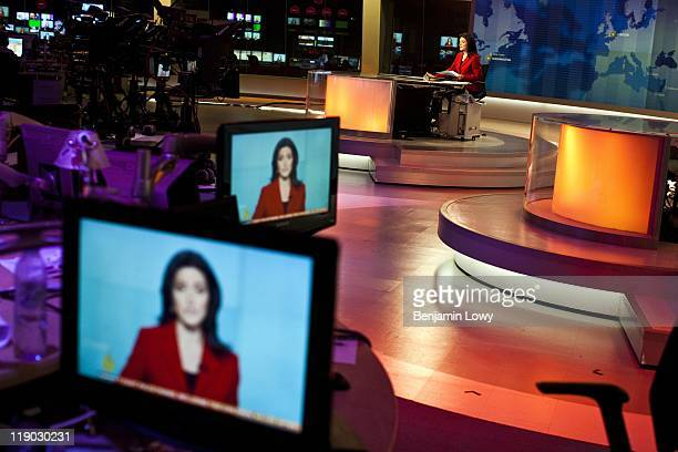 Anchor Ghida Fakhry presents the news during a live broadcast of Al Jazeera English on March 23 2001 from the channel's Doha based headquarters in...