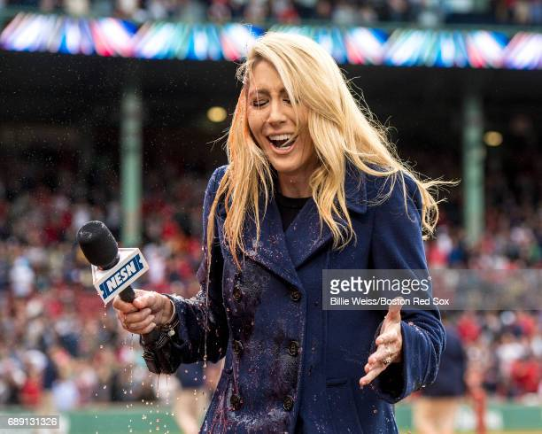 NESN anchor Guerin Austin reacts after being doused with Powerade while intervieweing Brian Johnson of the Boston Red Sox after pitching a complete...