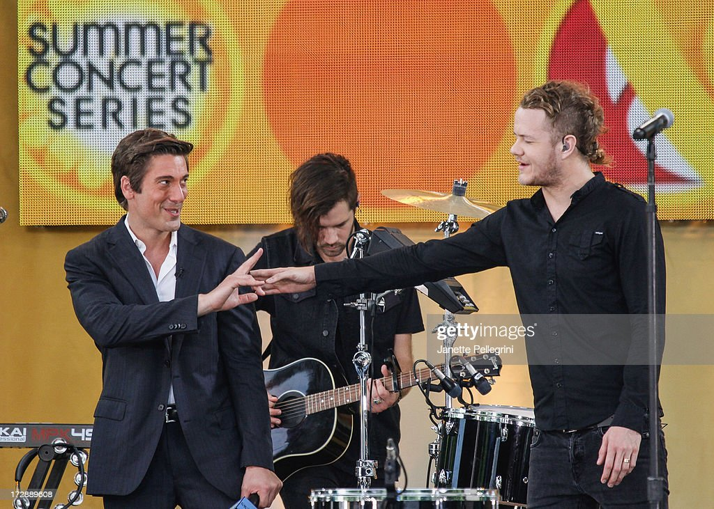 Anchor Josh Elliott (L) with Dan Reynolds of Imagine Dragons at ABC's 'Good Morning America' at Rumsey Playfield, Central Park on July 5, 2013 in New York City.