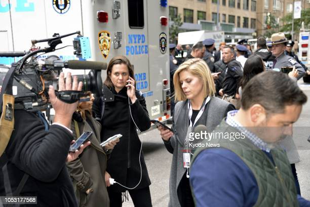 CNN anchor Kate Bolduan is on her phone outside the Time Warner Center which houses the New York bureau of the cable news network on Oct 24 after she...