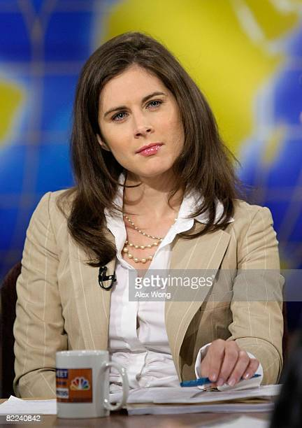 """Anchor of CNBC's """"Street Signs"""" Erin Burnett listens during a taping of """"Meet the Press"""" at the NBC studios August 10, 2008 in Washington, DC...."""