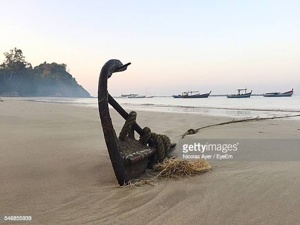 Anchor On Beach Against Clear Sky