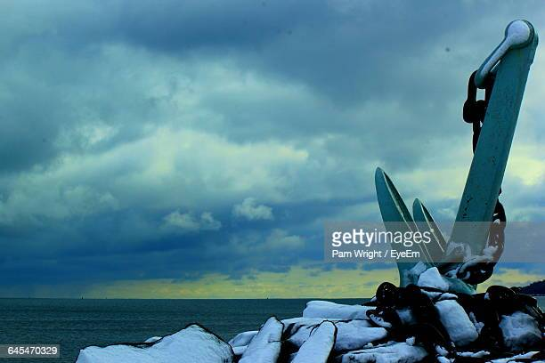 Anchor On Snow Covered Rock