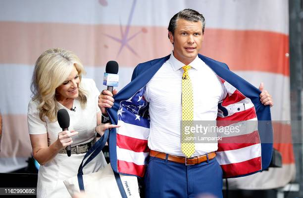 FOX anchor Pete Hegseth and meteorologist Janice Dean are on stage as Phil Vassar performs on FOX Friends AllAmerican Summer Concert Series on July...