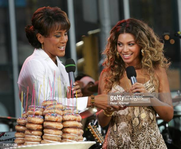 ABC Anchor Robin Roberts present donuts to singer Beyonce for her birthday on the Good Morning America show in Times Square on September 8 2006 in...