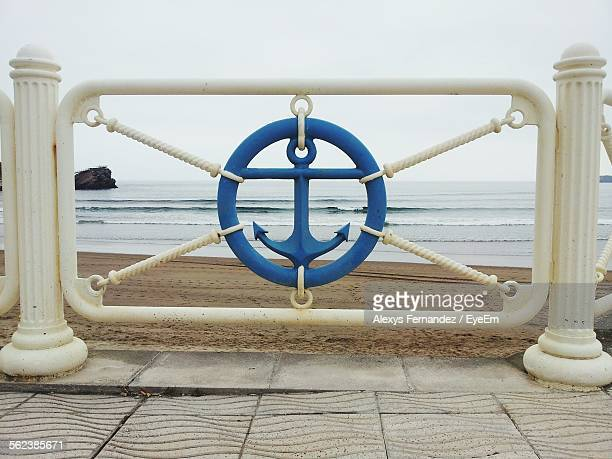 Anchor Symbol Against Beach