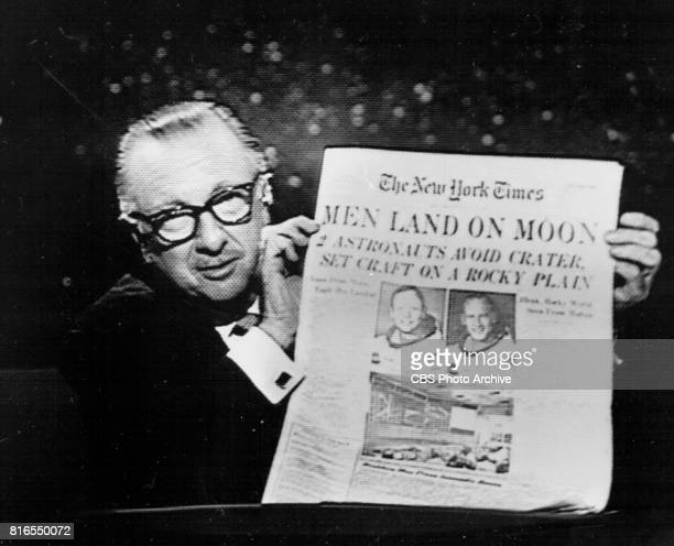 NEWS anchor Walter Cronkite holds up The New York Times during the Apollo 11 telecast July 20 1969 at 1011 PM