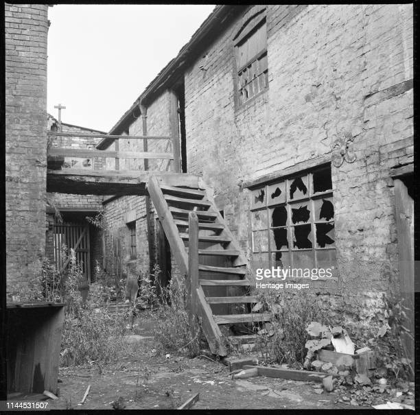 Anchor Works, Anchor Road, Longton, Stoke-on-Trent, 1965-1968. The courtyard at the rear of the Anchor Works showing the buildings in a dilapidated...