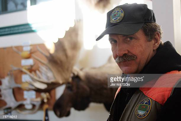 TO GO WITH AFP STORY by MIRA OBERMAN FILES Wildlife Biologist for Alaska Department of Fish and Game poses in at his office building in Anchorage...