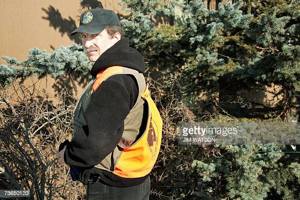 Wildlife Biologist for the Alaska Department of Fish and Game Rick Sinnott tracks a moose on a neighborhood trail in Anchorage Alaska 02 March 2007...