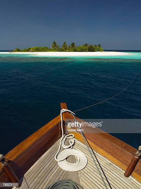 Anchored boat and island
