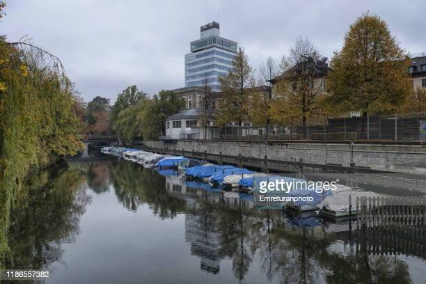 anchored boats along the canal and buildings at the background,zurich. - emreturanphoto stock pictures, royalty-free photos & images