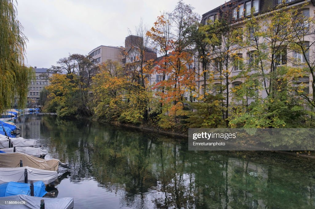 Anchored boats and buildings on waterfront ,Zurich. : Stock Photo