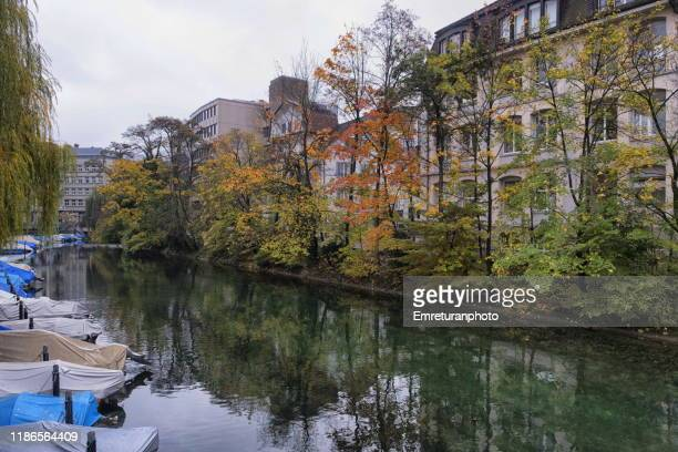anchored boats and buildings on waterfront ,zurich. - emreturanphoto stock pictures, royalty-free photos & images
