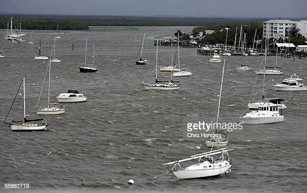 Anchored pleasure boats rock in the rolling sea October 24 2005 in Ft Myers Florida Hurricane Wilma made landfall in the early morning hours as a...