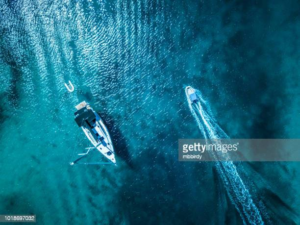anchored sailboat, view from drone - motorboat stock photos and pictures