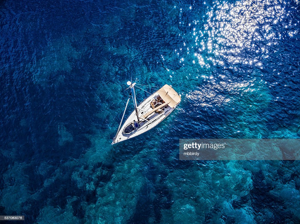 Anchored sailboat, view from drone : Stock Photo