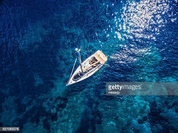 anchored sailboat, view from drone - adriatic sea stock pictures, royalty-free photos & images