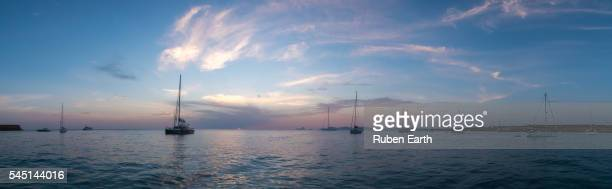 Anchored sailboats during sunset at the mediterranean