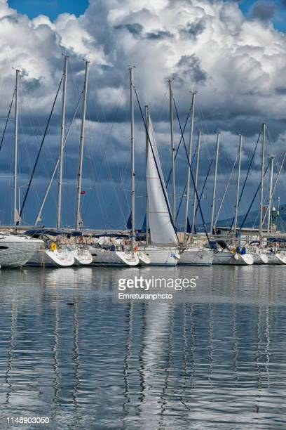 anchored sailboats in urla marina on a cloudy day. - emreturanphoto stock pictures, royalty-free photos & images
