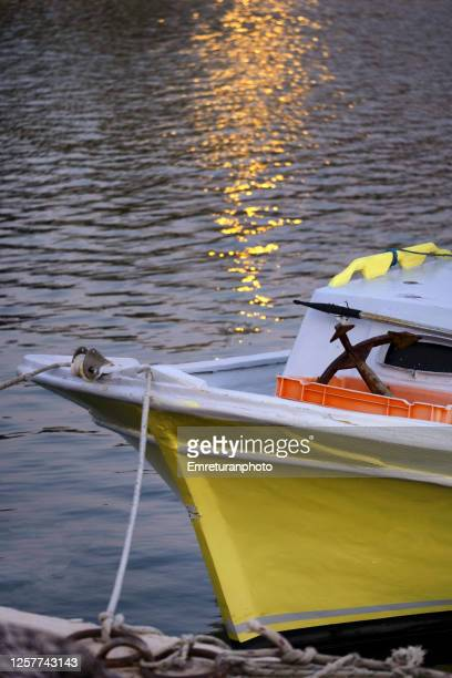 anchored yellow boat and reflections on water at sunset at dalyankoy. - emreturanphoto stock pictures, royalty-free photos & images