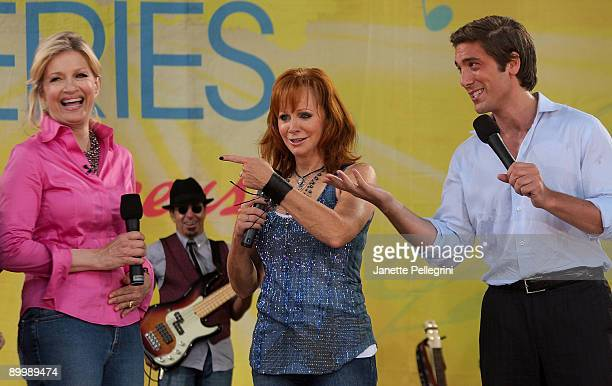 Anchors Diane Sawyer and David Muir with performer Reba McEntire attend ABC's 'Good Morning America' at Rumsey Playfield Central Park on August 21...