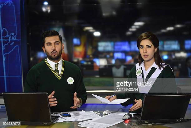 Anchors of Pakistan's largest private news channel Geo Absa Komal and Abdullah Sultan wear uniforms of the Army Public School as they broadcast the...