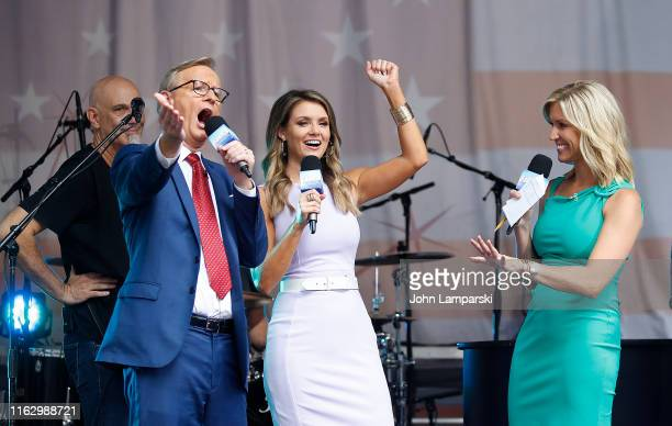 FOX anchors Steve Doocy Jillian Mele and Ainsley Earhardt are on stage as Phil Vassar performs on FOX Friends AllAmerican Summer Concert Series on...