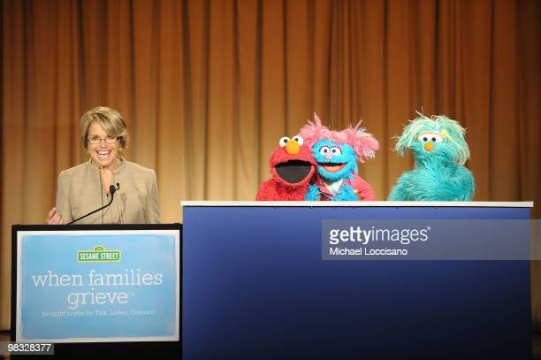 Anchorwoman Katie Couric and Sesame Street Muppets Elmo Jesse and Rosita address an audience and the press before a special tree planting ceremony...