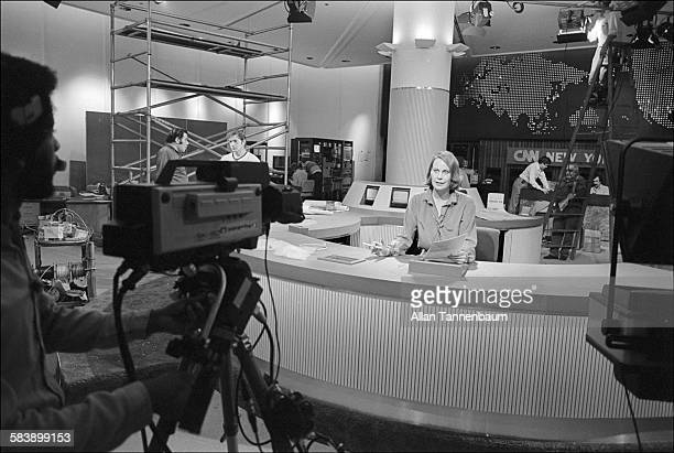 Anchorwoman Mary Alice Williams broadcasts from new cable TV news network CNN's studio during set construction in the World Trade Center lobby New...
