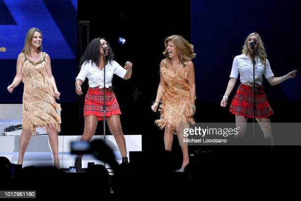 Anchorwomen Savannah Guthrie and Hoda Kotb dance on stage during a Rod Stewart performance at Madison Square Garden on August 7 2018 in New York City